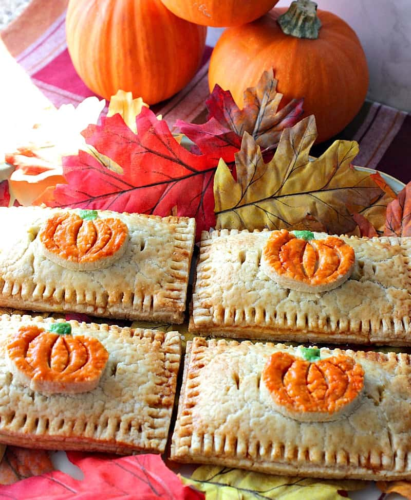Homemade Pumpkin Hand Pies Embellished with Colorful Pumpkin Crust