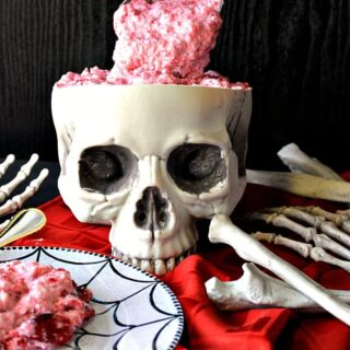 Spooning out the brains of a skull filled with brain food jello salad.