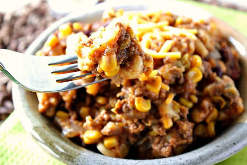 Closeup photo of slow cooker chili mac on a fork.