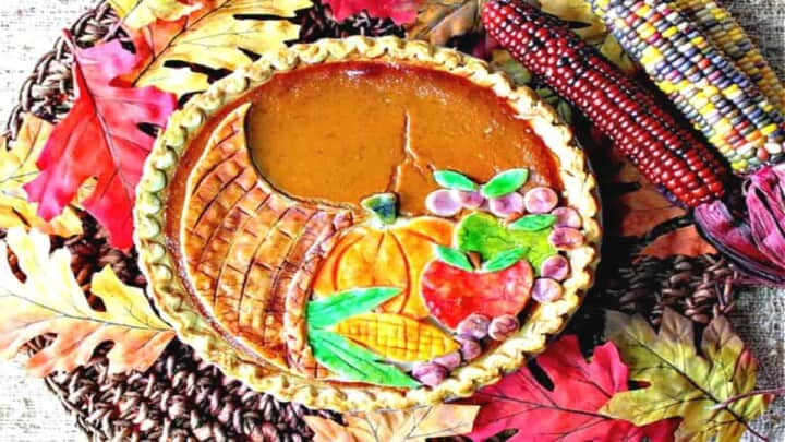 An overhead photo of a Cornucopia Pumpkin Pie with painted pie crust