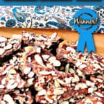 A vertical photo of double chocolate graham cracker toffee with nuts and title text overlay
