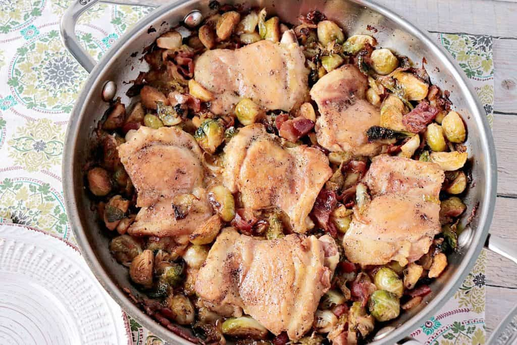 Skillet Chicken Thighs with Brussels Sprouts & Bacon - www.kudoskithenbyrenee.com