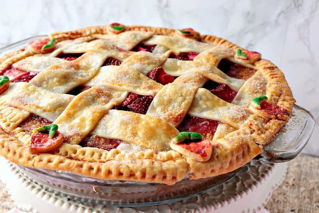 Lattice topped strawberry orange pie cake with strawberry pie crust accents.