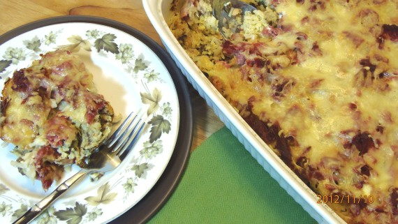 A casserole filled with corned beef hash strata and a plate with green leaves and a fork for a popular St. Patrick's day recipes roundup post.