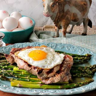 Buttery Rich Steak & Eggs Over Asparagus - www.kudoskitchenbyrenee.com