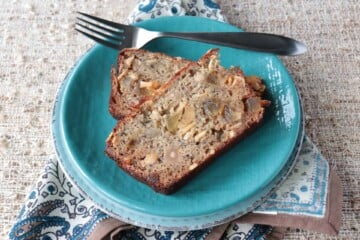 Gluten Free Tropical Banana Bread with Almond Flour, Macadamia Nuts, Pineapple, and Coconut Chips is simply delicious! - kudoskitchenbyrenee.com