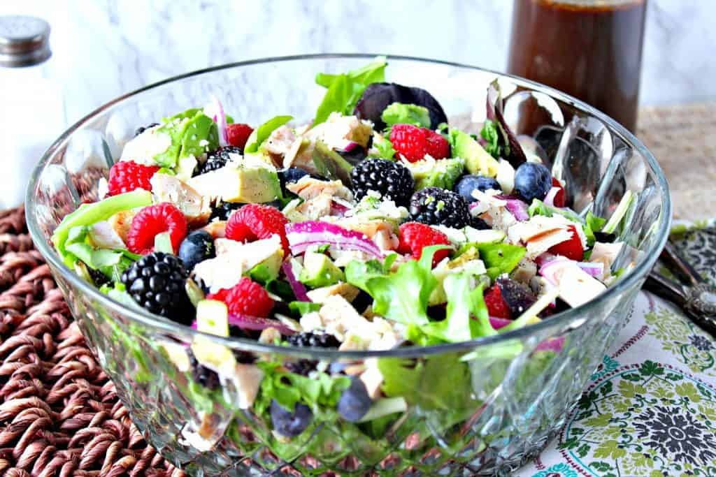 Berry, Chicken and Avocado Salad in a large glass salad bowl.