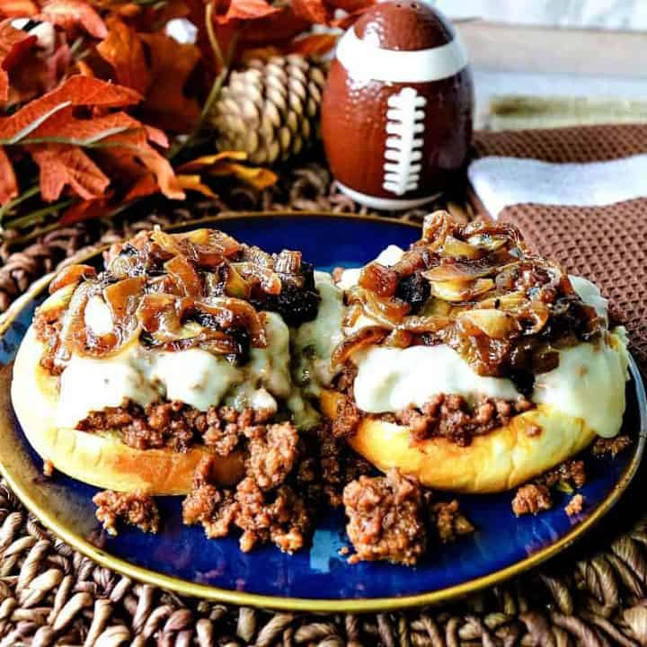 Open faced sloppy joes with cheese and caramelized onions.