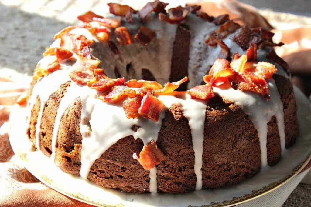 Bundt Cake with icing and bacon.