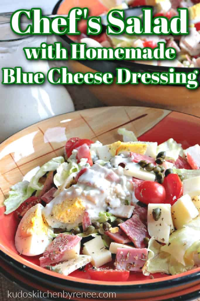 A title text overlay graphic for a vertical closeup of a chef's salad with homemade blue cheese dressing with tomatoes, eggs, meats, and cheeses