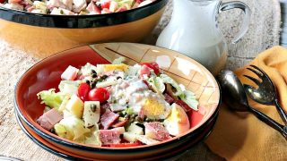 A bowl filled with a homemade Chef's Salad with Blue Cheese Dressing.