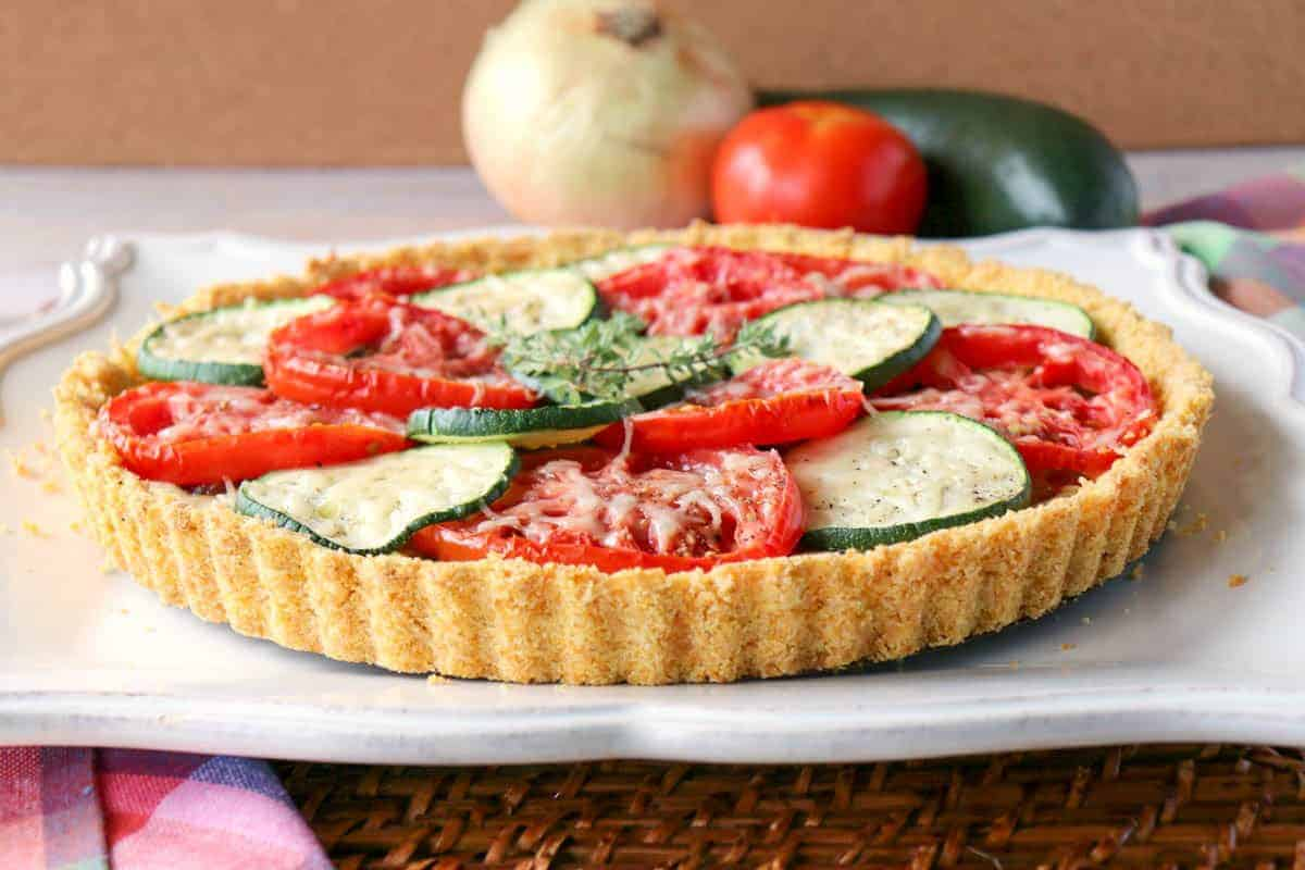 Fresh Tomato Tart with Zucchini & Caramelized Onions - kudoskitchenbyrenee.com