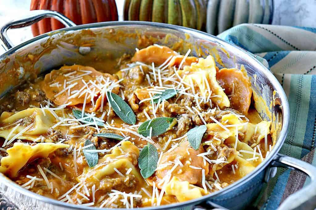 Easy Ravioli with Pumpkin Vodka Sauce & Sausage is a proof positive that serving pumpkin for dinner is always a winner! - kudoskitchenbyrenee.com