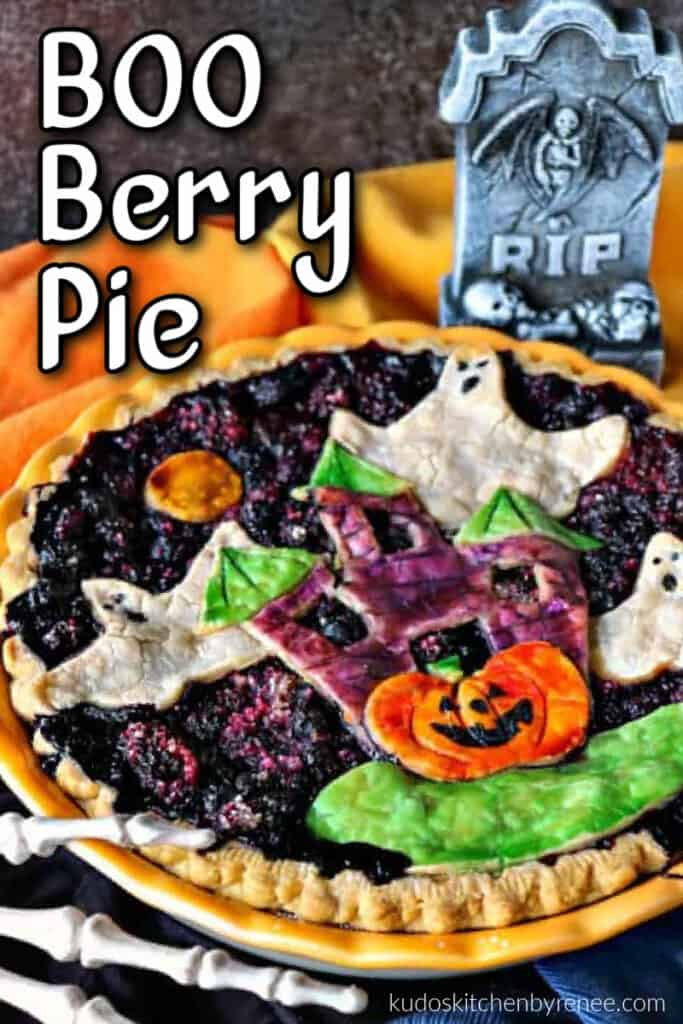 A closeup colorful Boo Berry Pie with painted haunted house and ghosts pie crust.