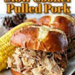A closeup photo of a slow cooker pulled pork sandwich with title text graphic on a pretzel bun