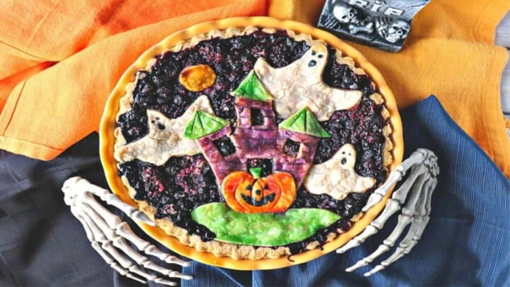 A Boo Berry Pie with skeleton hands and a fun Halloween painted pie crust