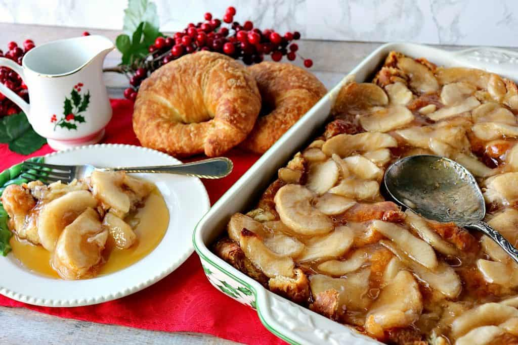 A horizontal photo of a casserole dish filled with apple croissant breakfast bake with a Christmas theme.