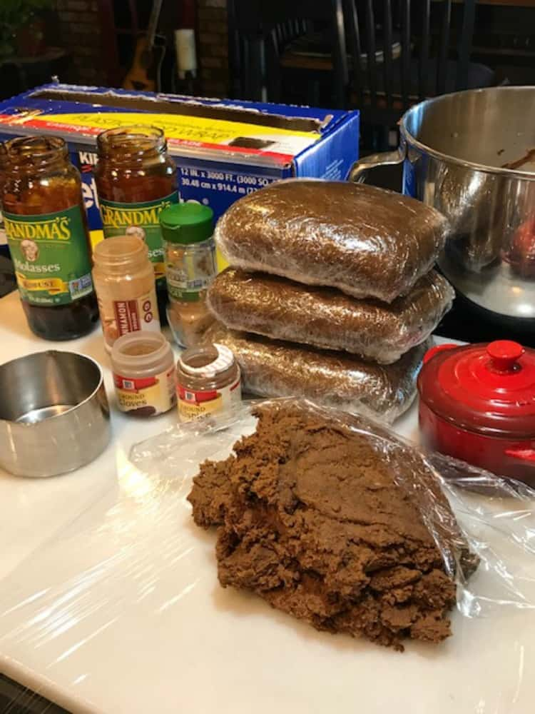 A photo of gingerbread dough and the ingredients for making Gingerbread House Recipe and Tutorial