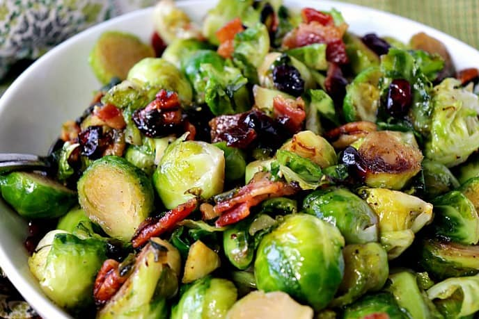 Closeup of Sauteed Brussels sprouts with sweet and spicy candied bacon.