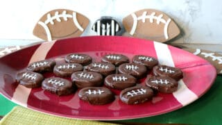 A football tray filled with Peanut Butter and Jelly Chocolate Footballs