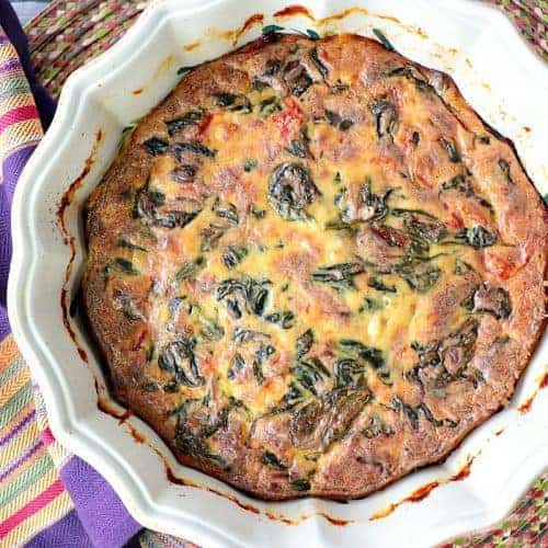 Overhead picture of spinach casserole in a round dish