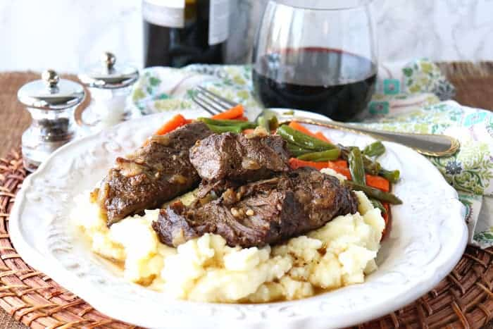 Plate of braised boneless short ribs on over mashed potatoes