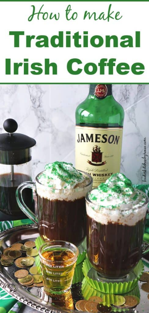 Title Text vertical image of two mugs of Irish coffee on a silver tray with a shot of Irish whiskey in the foreground and a bottle in the background.