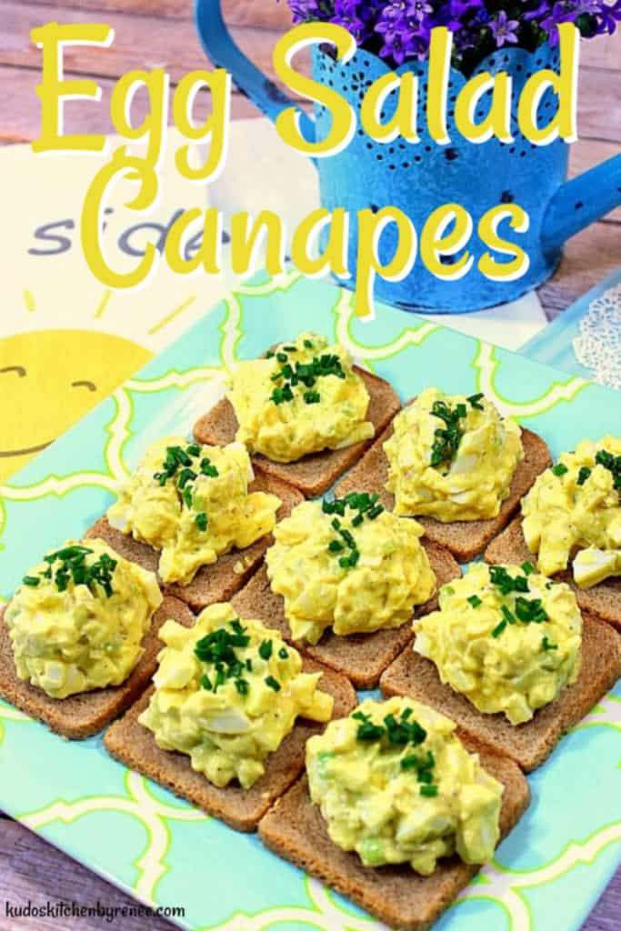 A vertical closeup image of Egg Salad Canapes on a blue and yellow plate with a title text overlay graphic.