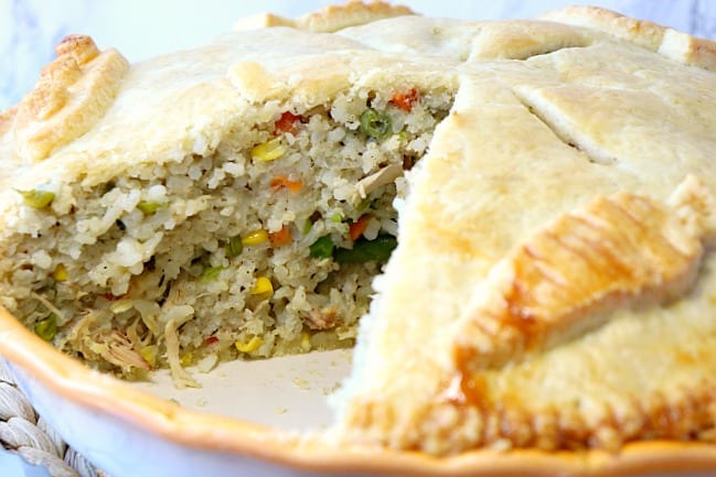 Closeup photo of Chicken and Rice Pot Pie with a slice taken out.