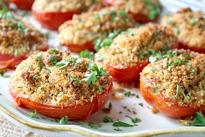 Stuffed tomatoes on a platter for a bbq side dish recipes roundup