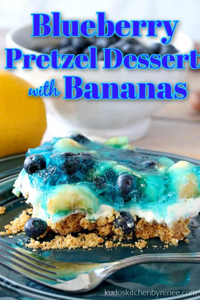 A closeup vertical picture of a slice of blueberry pretzel dessert on a blue plate with a fork and title text overlay graphic