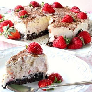 A slice of Neapolitan Ice Cream Cake in the forefront and an entire ice cream cake in the background.