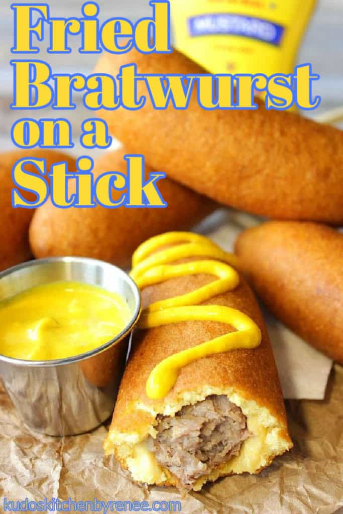 A closeup vertical photo of a fried bratwurst on a stick with yellow mustard and a title text overlay graphic