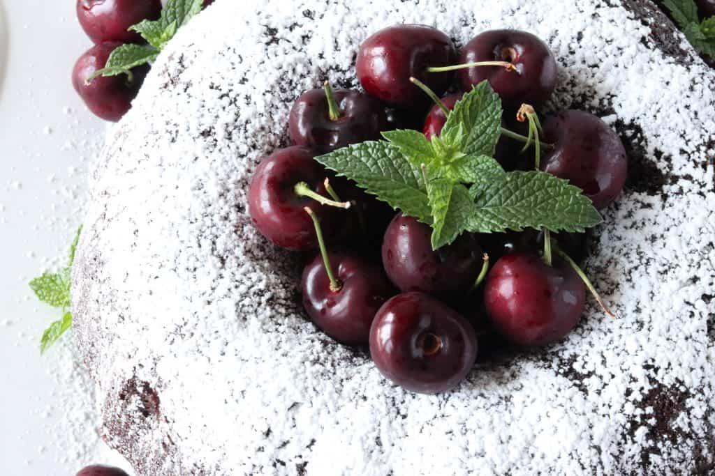 Overhead photo of a chocolate cherry bundt cake for chocolate dessert recipes roundup