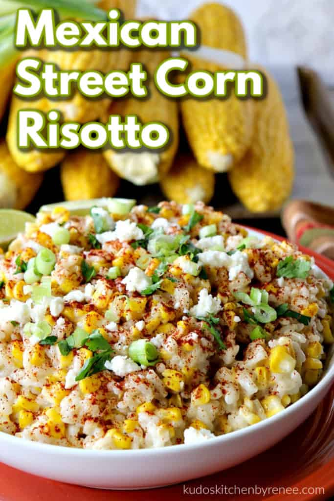 A closeup photo of Mexican street corn risotto in a bowl with cheese and green onions as garnish.