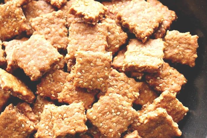 Closeup photo of homemade honey sesame seed crackers.