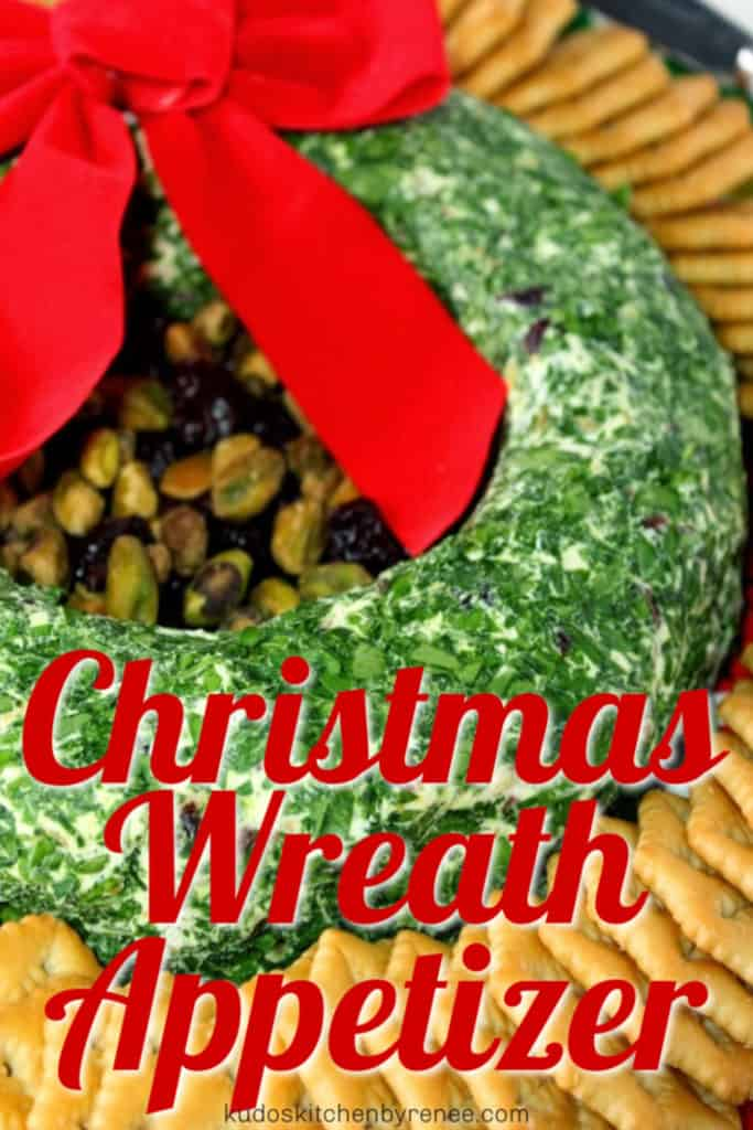 A vertical title text closeup image of a goat cheese Christmas wreath appetizer with parsley and crackers.