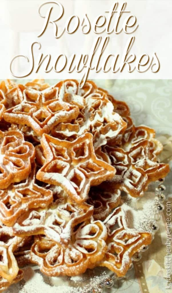 Closeup vertical title text image of fried rosette snowflake cookies on a glass platter with confectioners sugar.