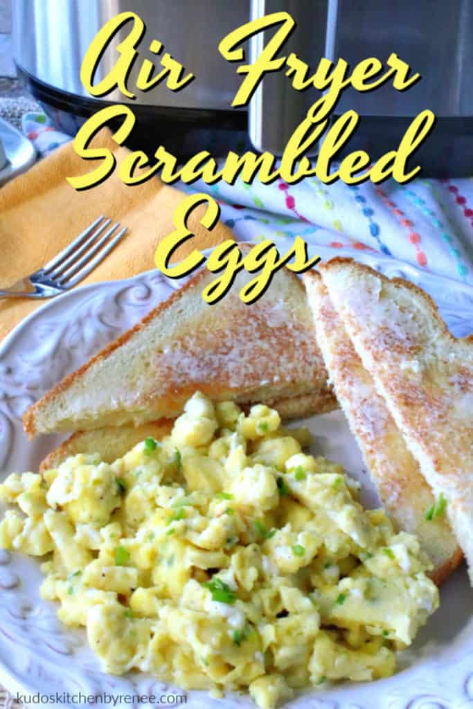 A closeup vertical title text image of air fryer scrambled eggs on a plate with chives, a yellow napkin, and a fork.