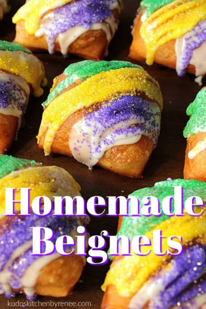 Closeup vertical title text image of fried beignets with purple, green, and gold sugar for Mardi gras.