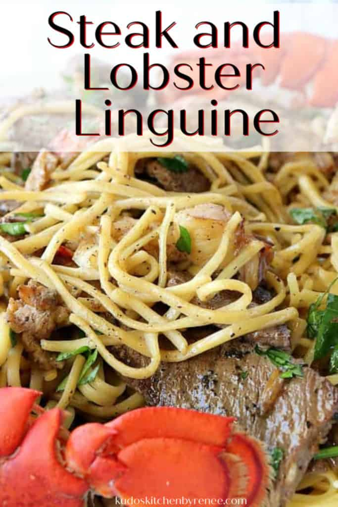 A closeup vertical image of steak and lobster linguine with parsley, lobster tails, and title text overlay graphic.