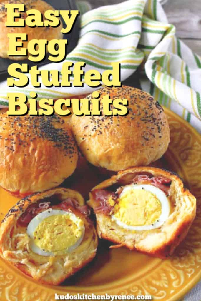 A vertical closeup title text image easy breakfast recipe of egg stuffed biscuits cut in half with ham and cheese.