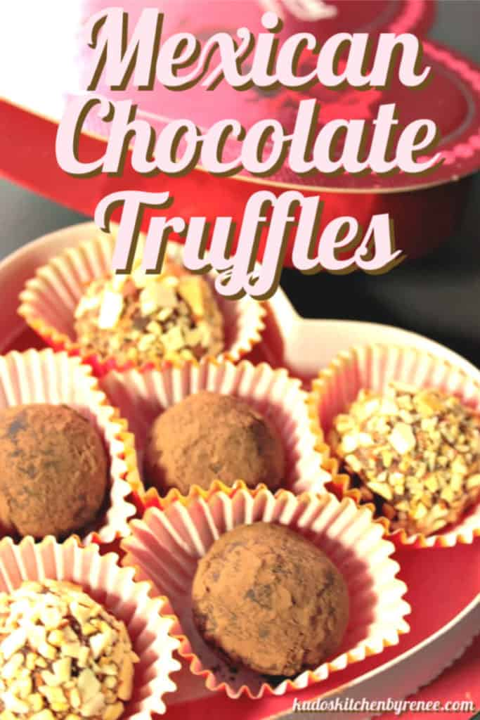 A vertical closeup photo of Mexican Avocado Truffles in a heart shaped box with title text overlay graphic.