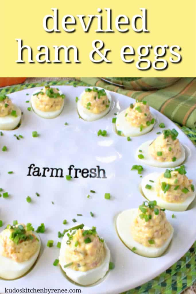 A vertical title text image of a white farm fresh plate of deviled Dijon ham and eggs with chopped chives as garnish.