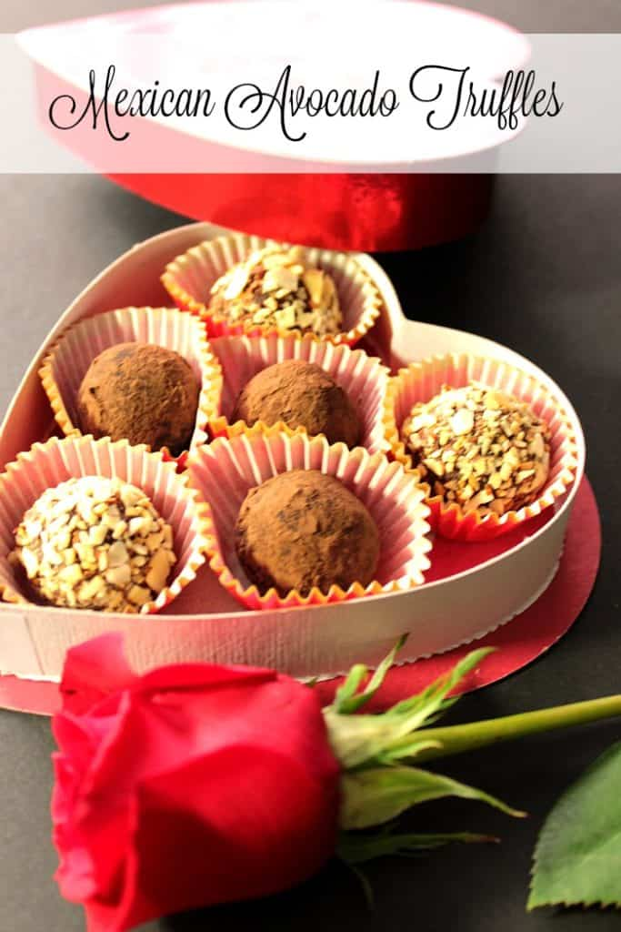 A vertical title text image of a heart box filled with Mexican chocolate truffles with avocados.