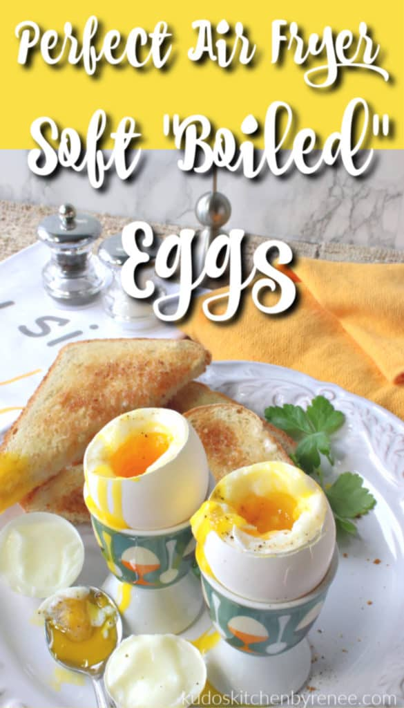 Vertical title text image of air fryer soft boiled eggs in egg cups on a white plate with toast and parsley.