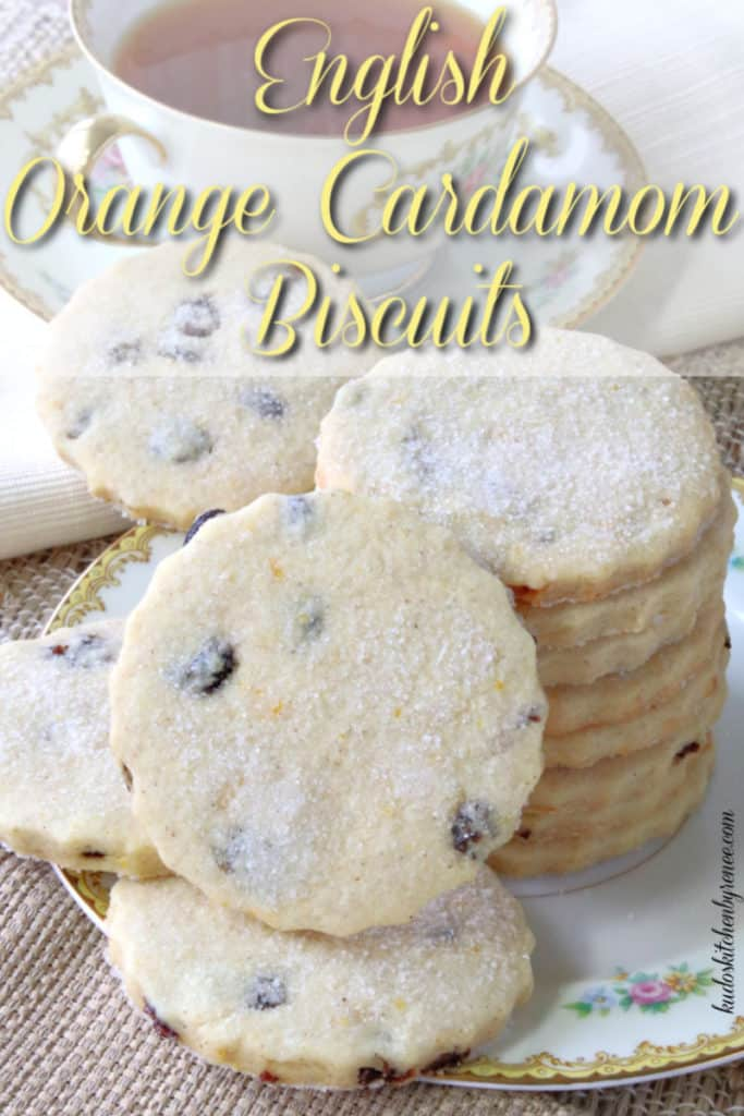 Title text vertical image of a stack of English Orange Cardamom biscuits with currants and a sugar dusting.