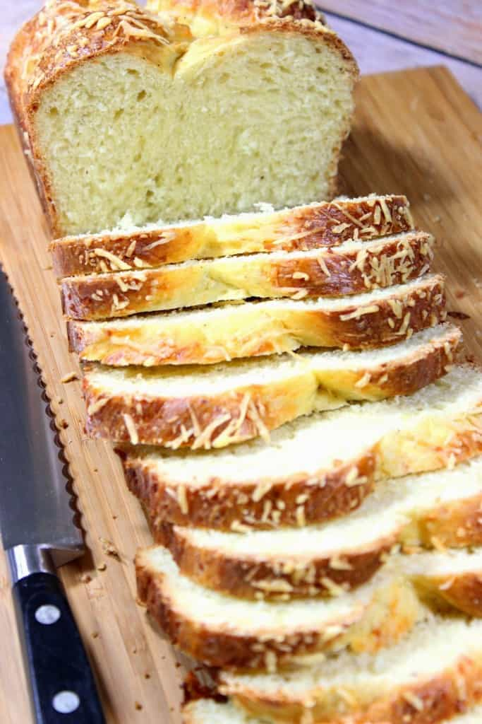 Vertical image of a sliced loaf of Italian Easter cheese bread