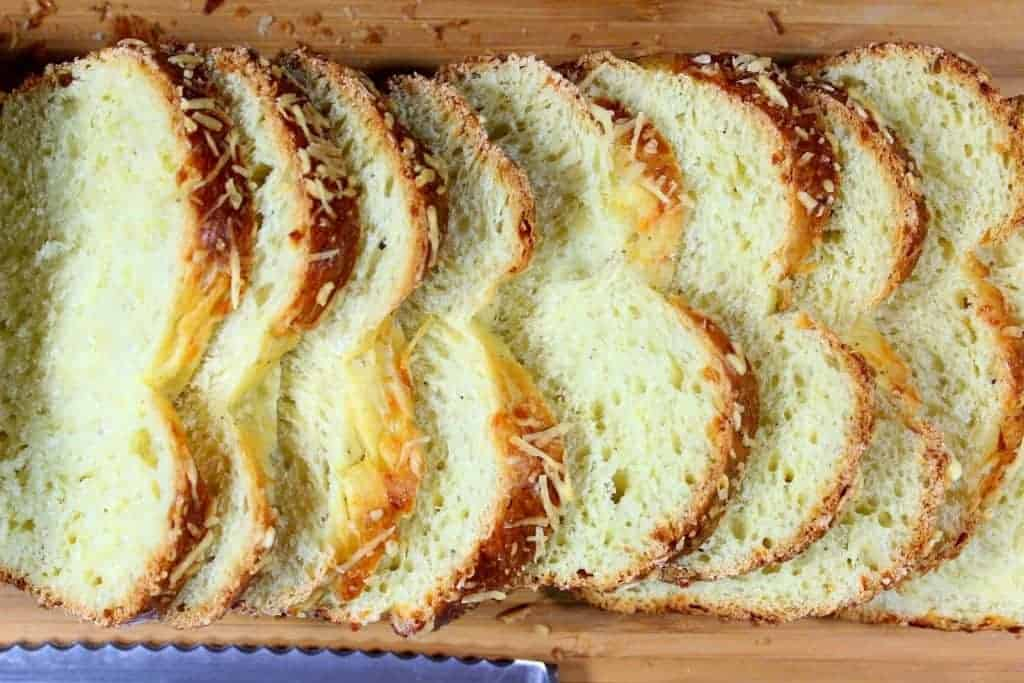 Overhead horizontal photo of a sliced loaf of Italian Easter cheese bread.
