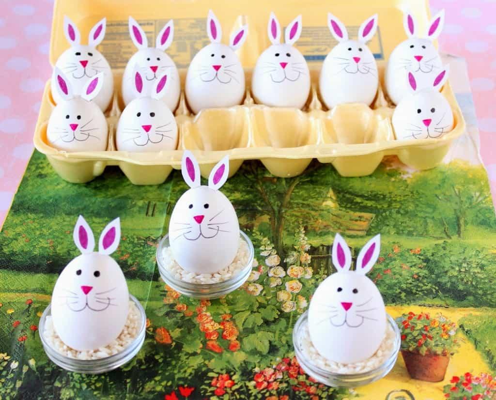 Super cute hard-boiled bunny eggs on a colorful garden themed napkin.
